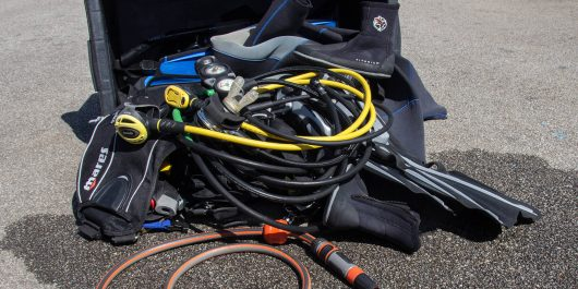 A Bin Full Of Dive Gear To Be Cleaned After A Dive In Brittany, France, Europe