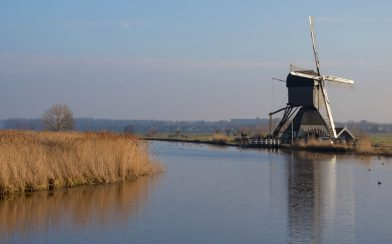 A Canal And Windmill Horizon Picture In The Netherlands