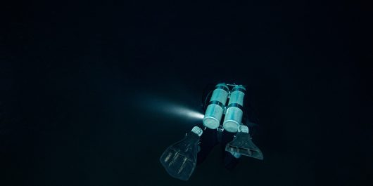 A Double Tank Diver Exploring The Underwater World In The Dark Of Night, Mexico