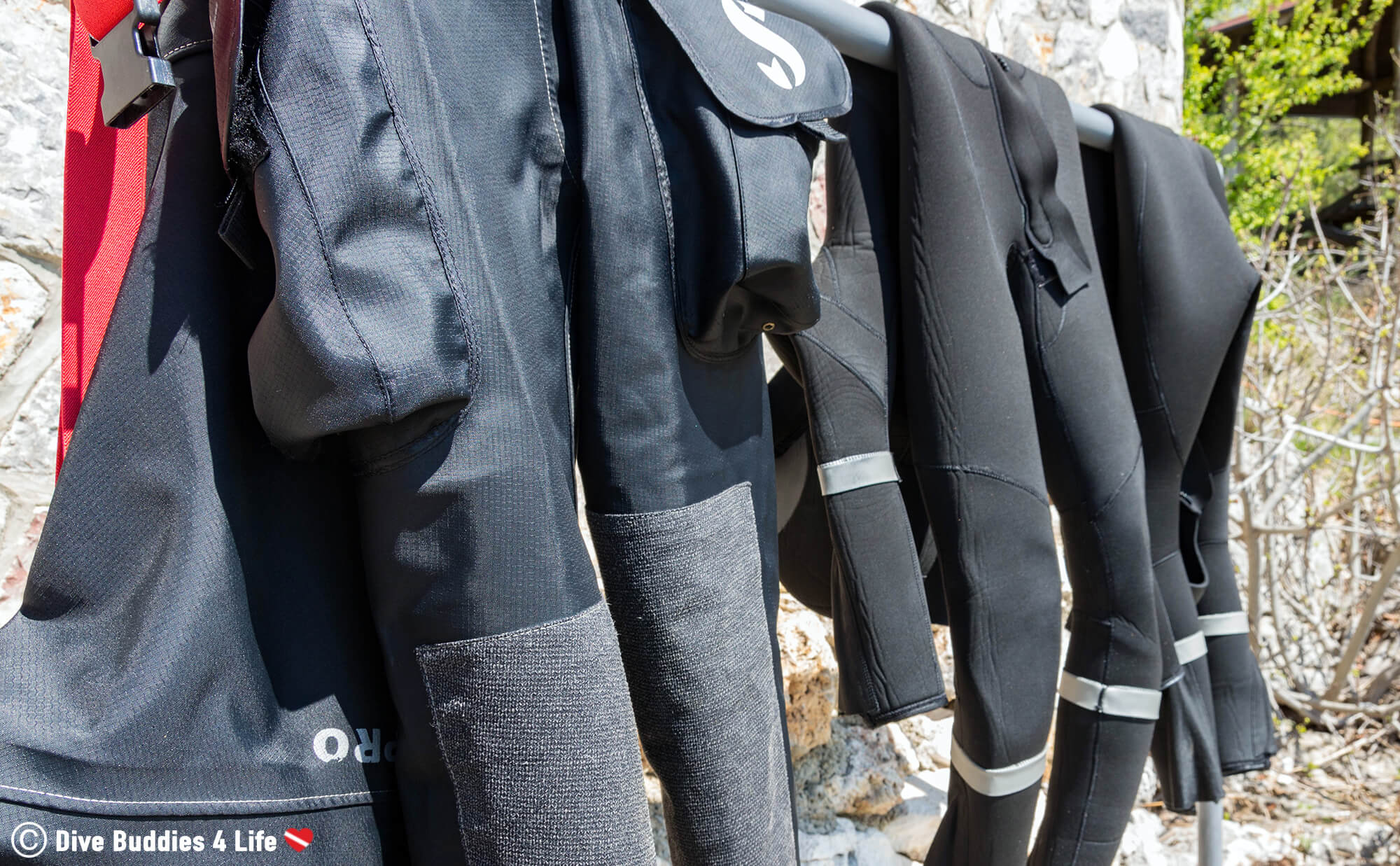 A Drysuit And Wetsuit Hanging Out To Dry In The Shade After Being Rinsed In A Freshwater Bin In Macedonia, Europe