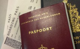 A Dutch And Canadian Passport And Flight Tickets