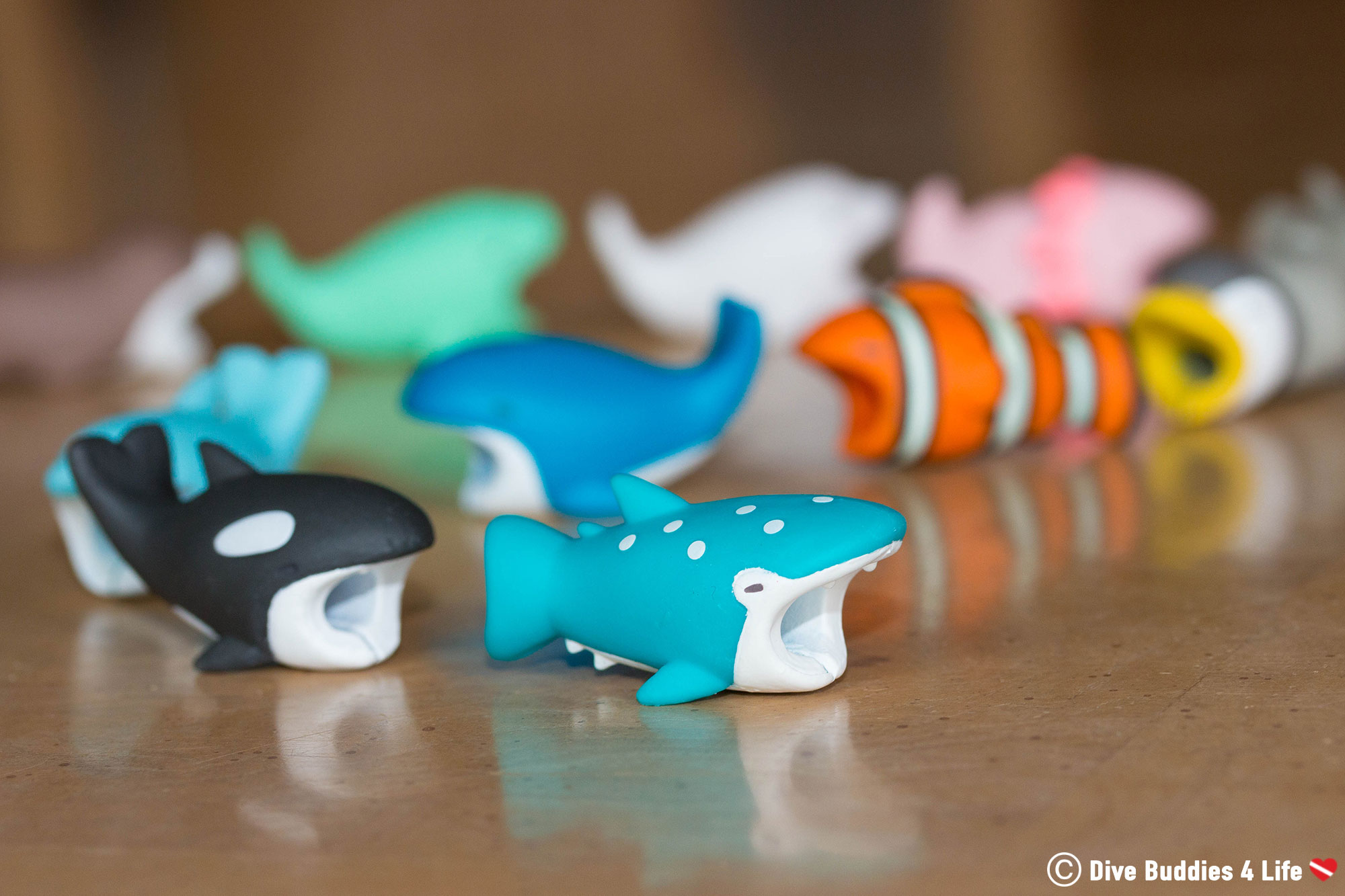 A Line Up Of Marine Animal Cable Bites To Protect Charging Cords