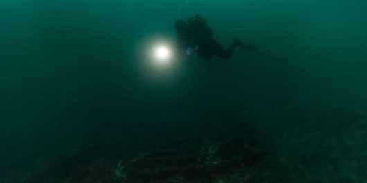 A Lone Diver Floating Under The Water Of Peniche, Portugal No Watermark