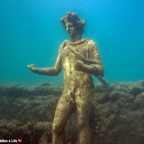A Roman Statue Underwater At The Baiae Dive Site In Naples, Italy, Europe
