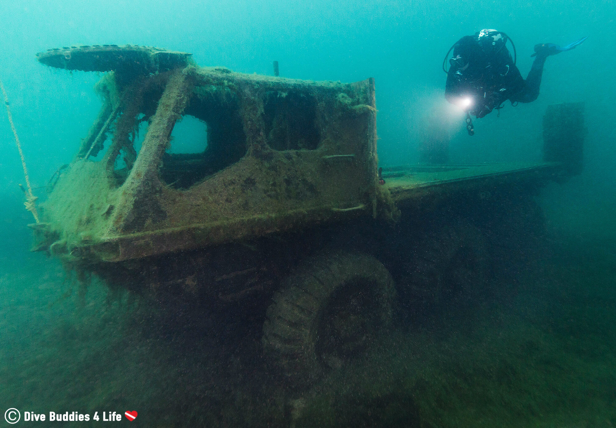 A Scuba Diver Above An Army Truck In The Chepstow Quarry, United Kingdom