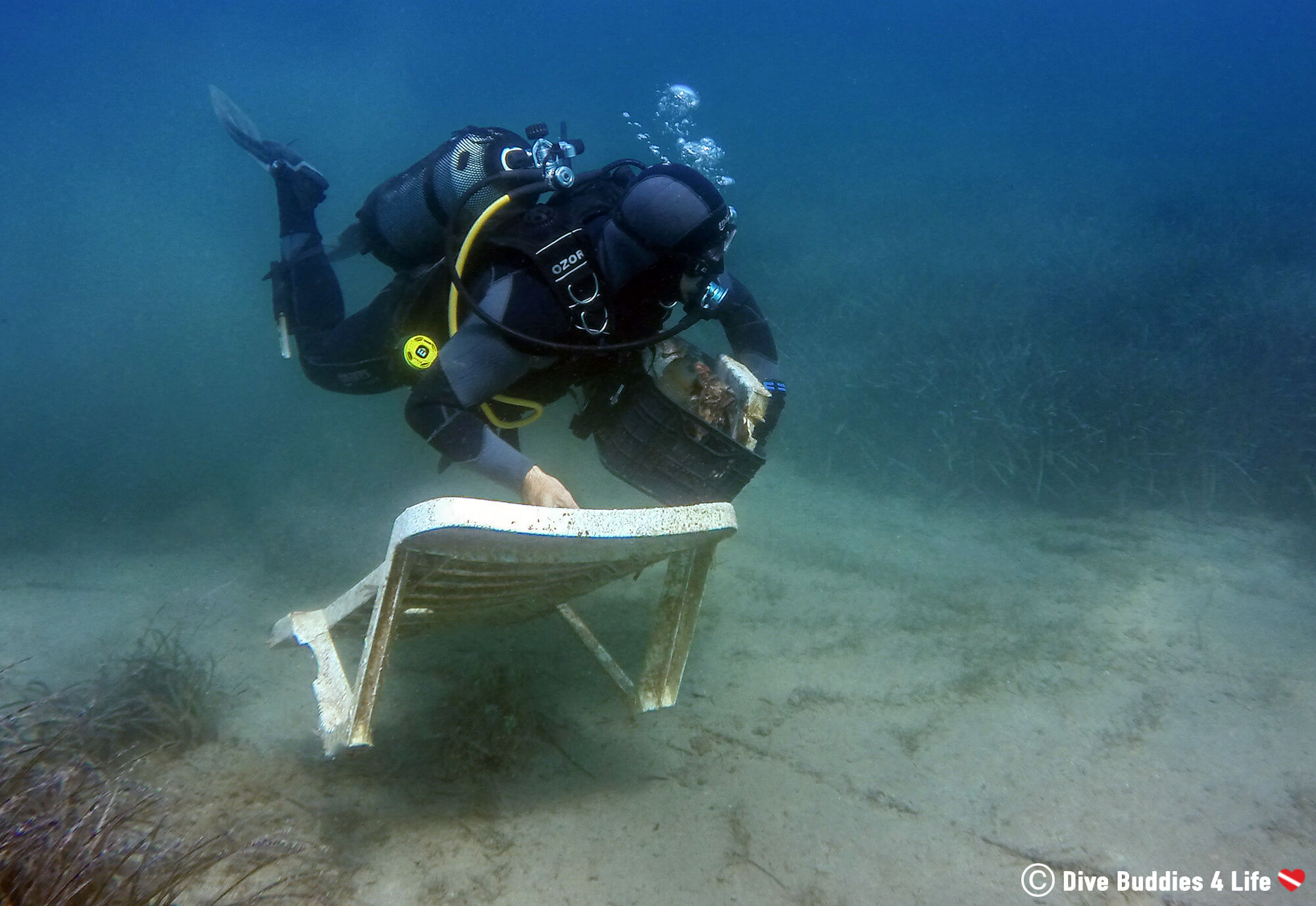 A Scuba Diver Cleaning Up The Bottom Of The Sea In The Balkan Country Of Albania, Europe