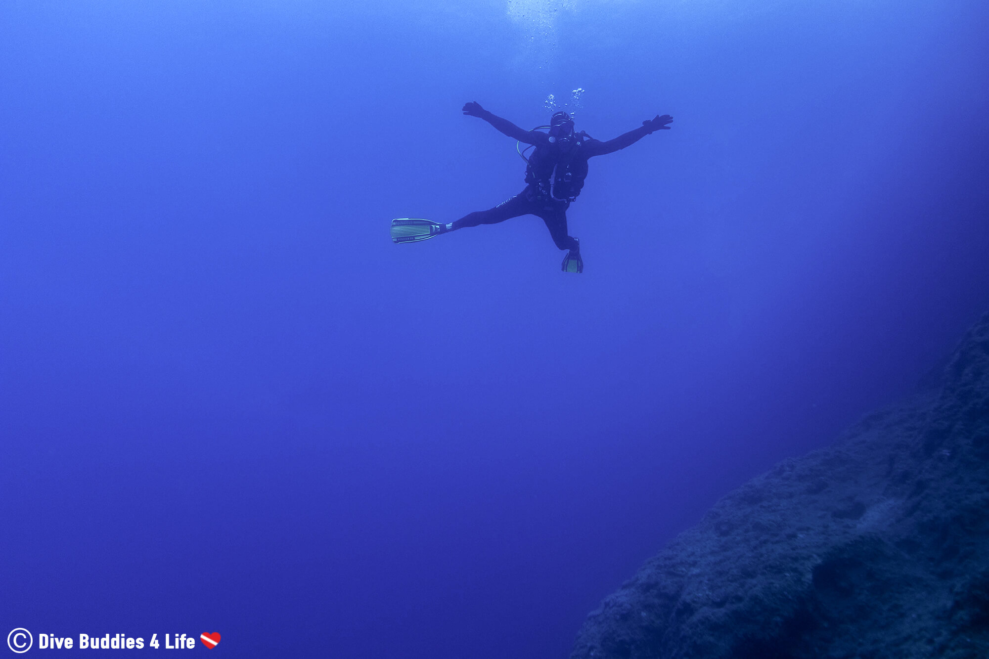 A Scuba Diver Floating In The Mediterranean Sea Of Zakynthos Island, Greece