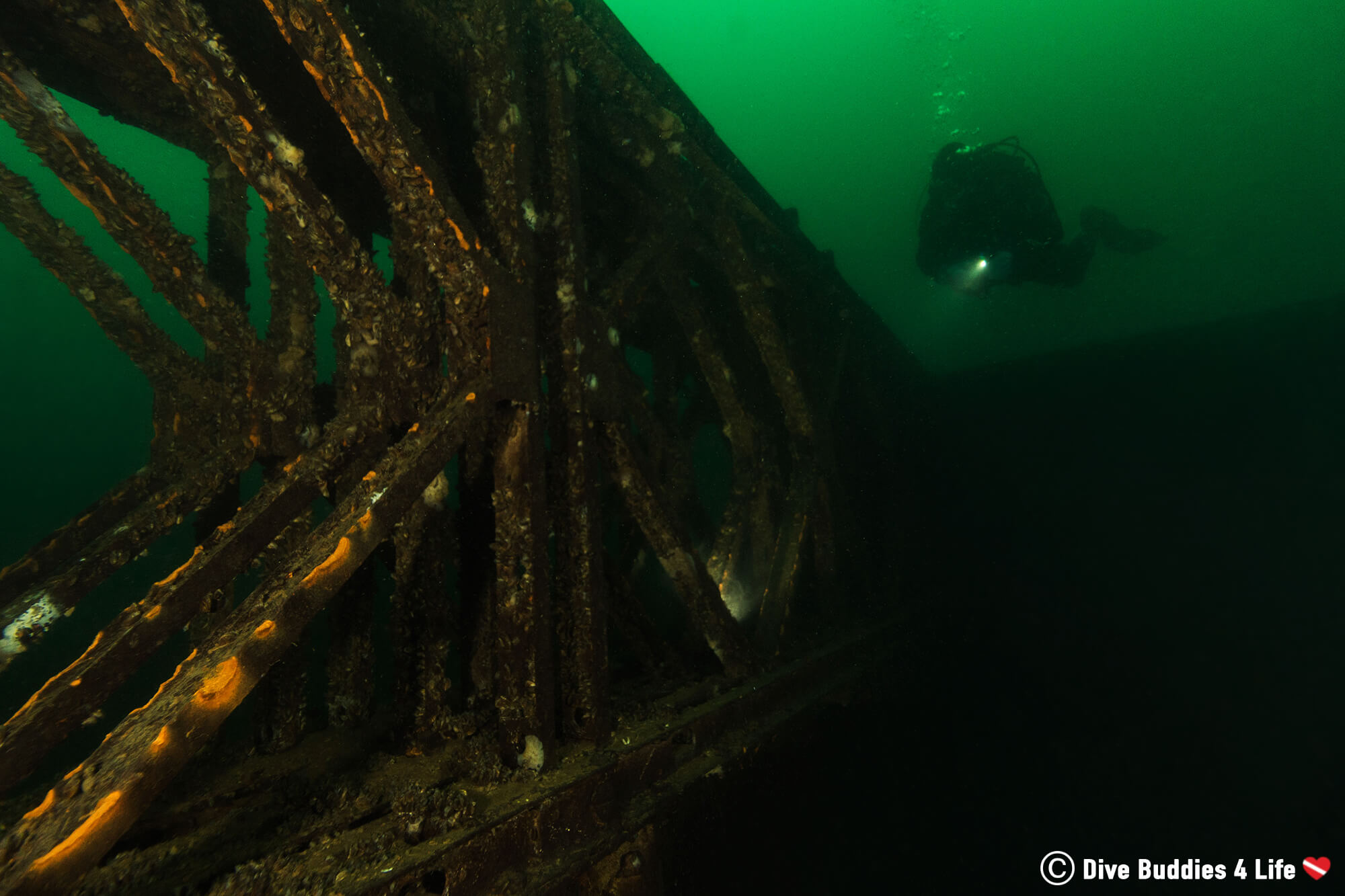 A Scuba Diver Silhouette In The Submerged Crushing Works Of Vobster Quay, England, United Kingdom