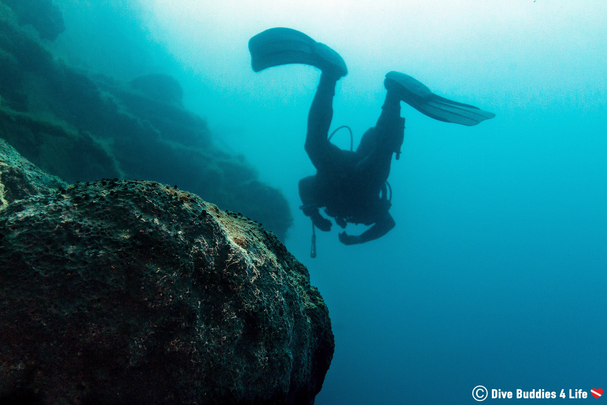 A Scuba Diver Swimming In The Blue Sea Of Albania In Eastern Europe