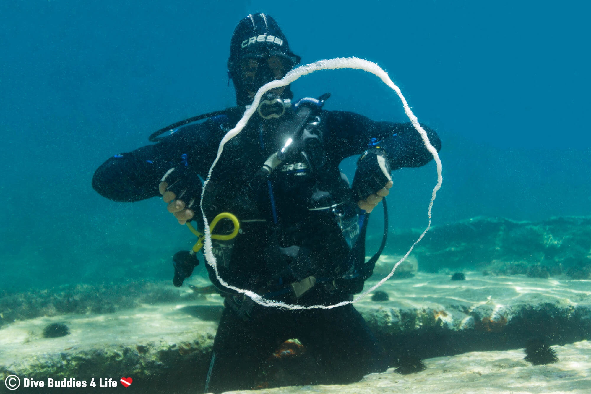 A Scuba Diver In Montenegro Making Bubble Rings Underwater, Budva, Europe