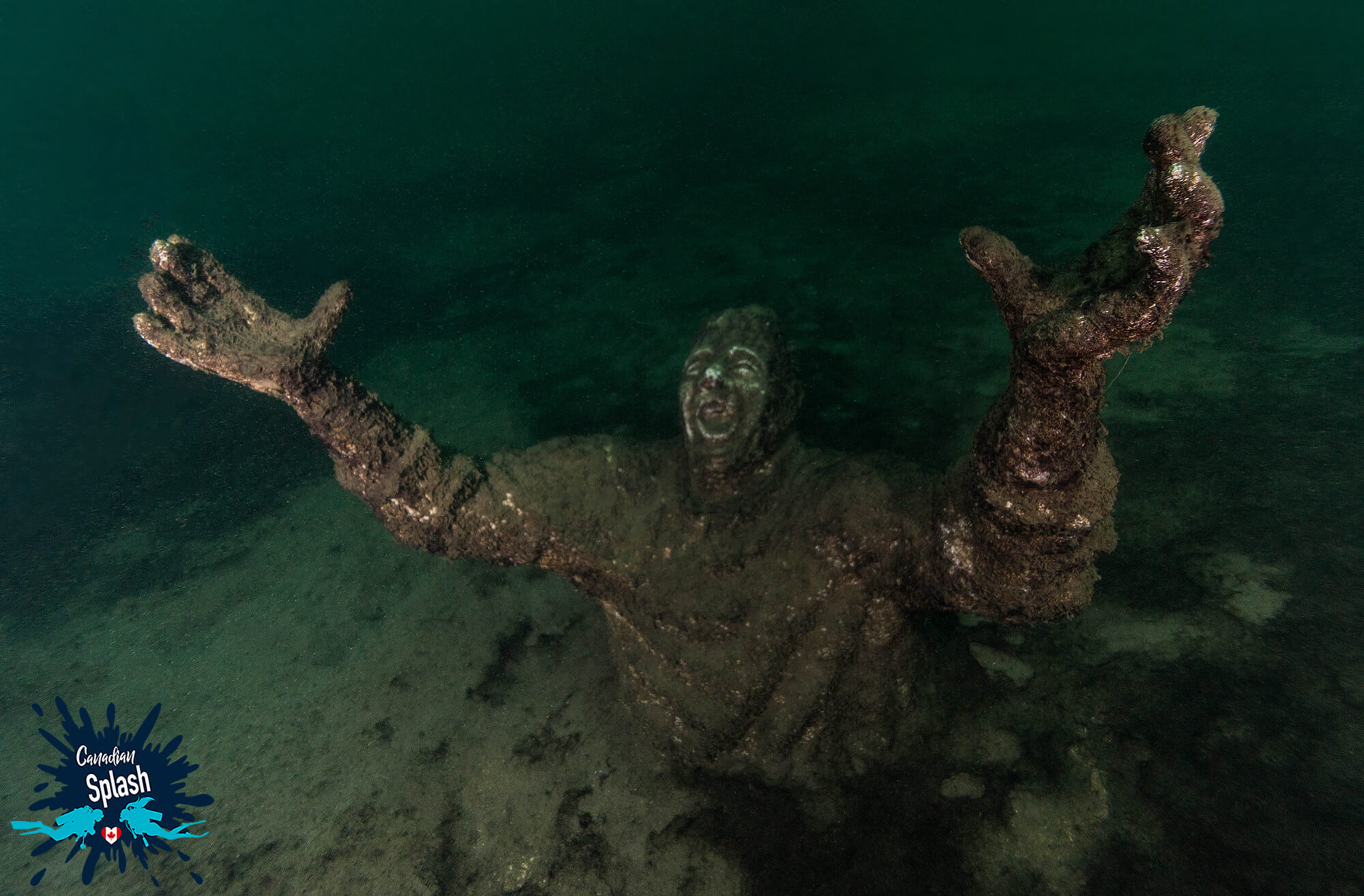 A Statue With Arms Wide Open In Centeen Park, Brockville, Ontario Scuba Diving, Canada