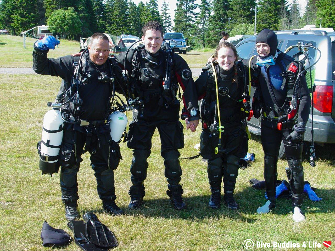 A Team Of Scuba Divers After Completing Their Advanced Open Water Certification With The PADI Scuba Diving Agency