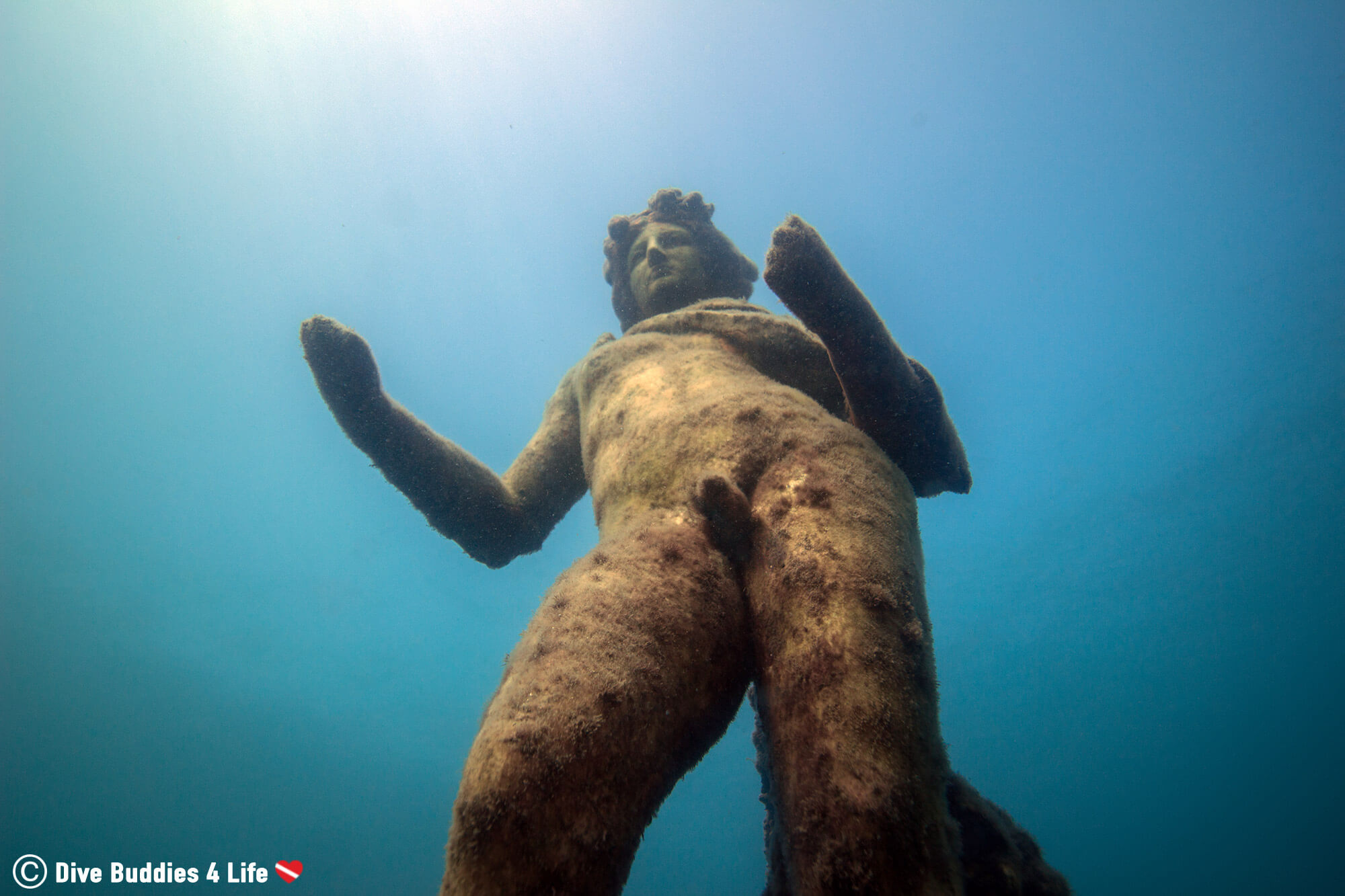 A View Of A Nude Roman Statue Submerged In The Waters In The Gulf Of Naples At Baiae, Italy, Europe