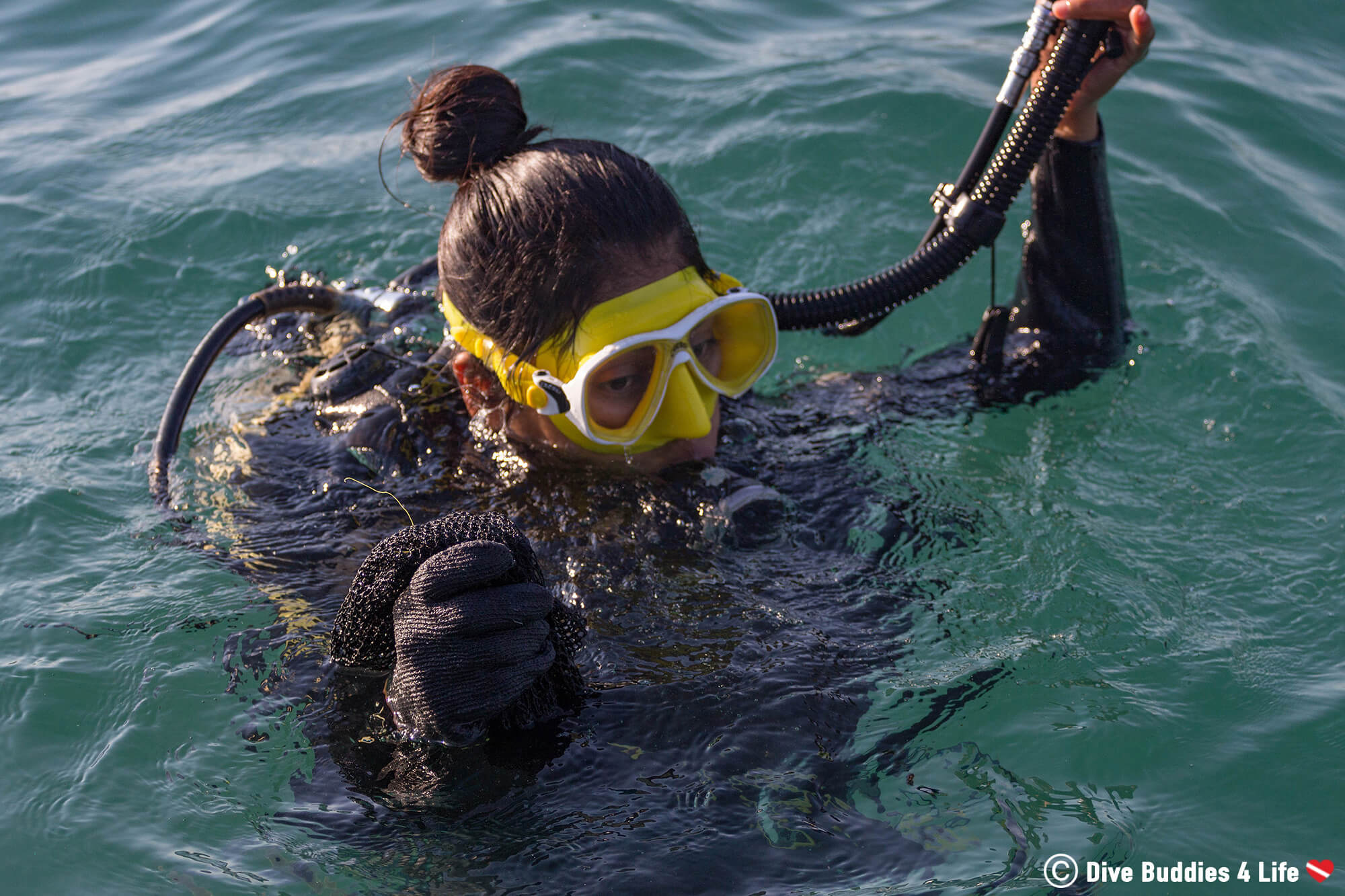 A Woman Scuba Diver Going Down To The Bottom Of Zihua Beaches To Look For Plastic, Mexico