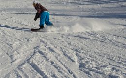 Ali Carving On Her Snowboard
