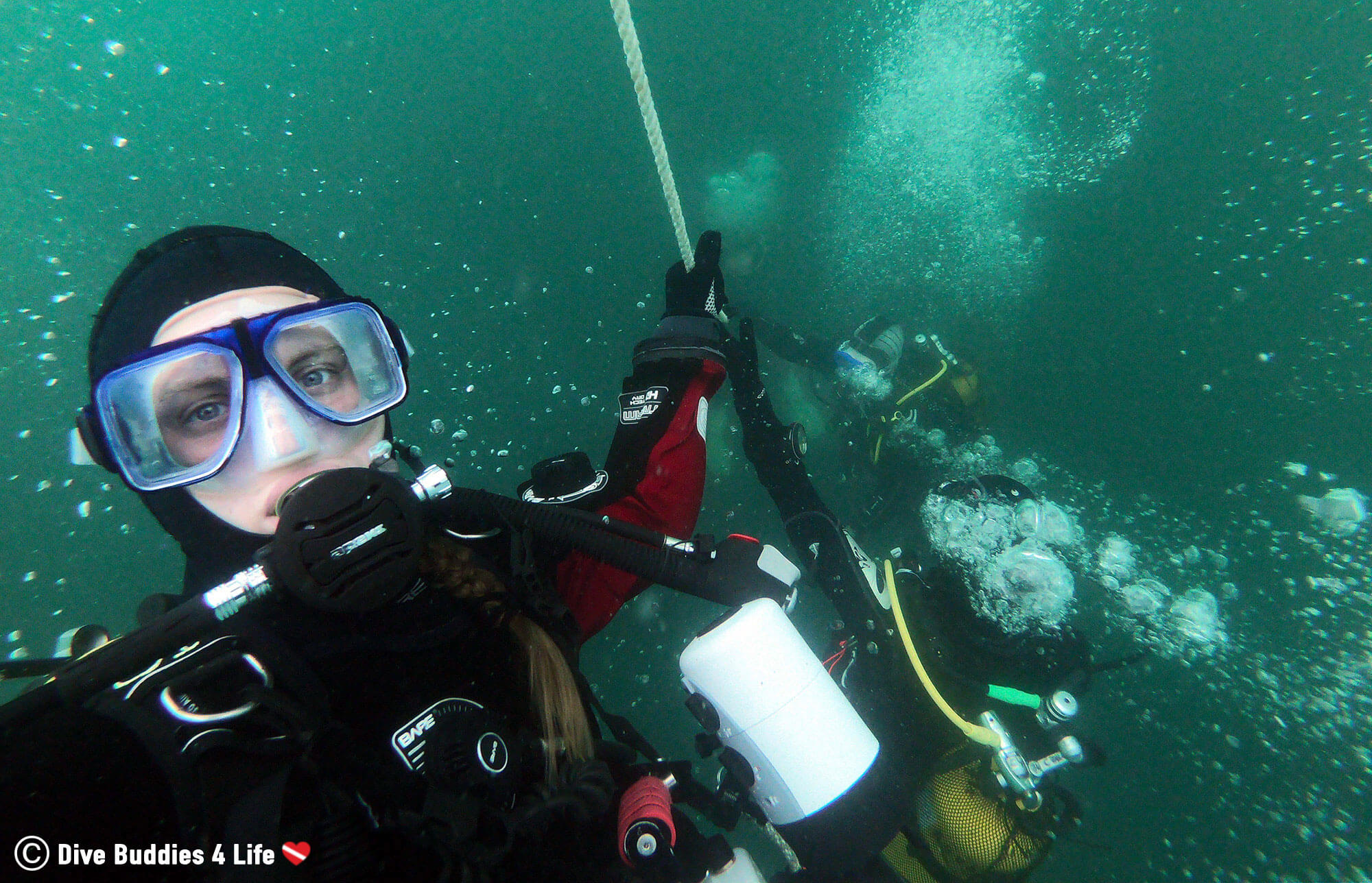 Ali Descending The Rope To A Shipwreck In Her Dive Gear With A Hood
