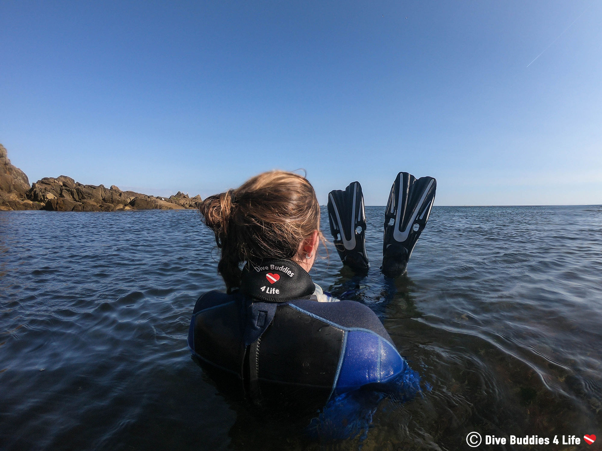 Ali Floating In The Cold Water Of France In Her Snorkeling Gear