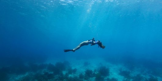 Ali Free Diving With Her Mermaid Hair Loose In The Ocean Of Bonaire, Caribbean