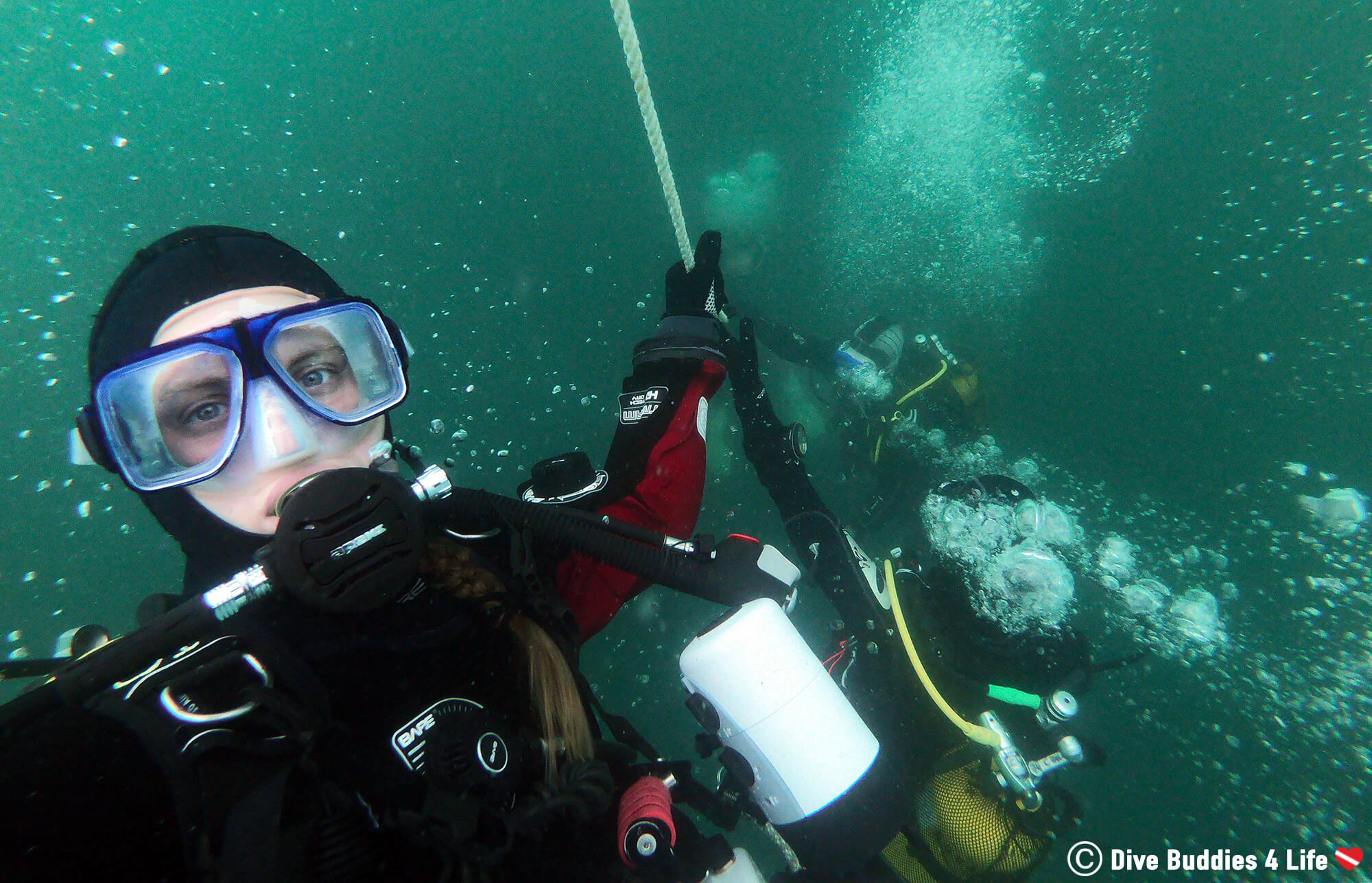 Ali Going Down The Underwater Rope In Her Dive Gear