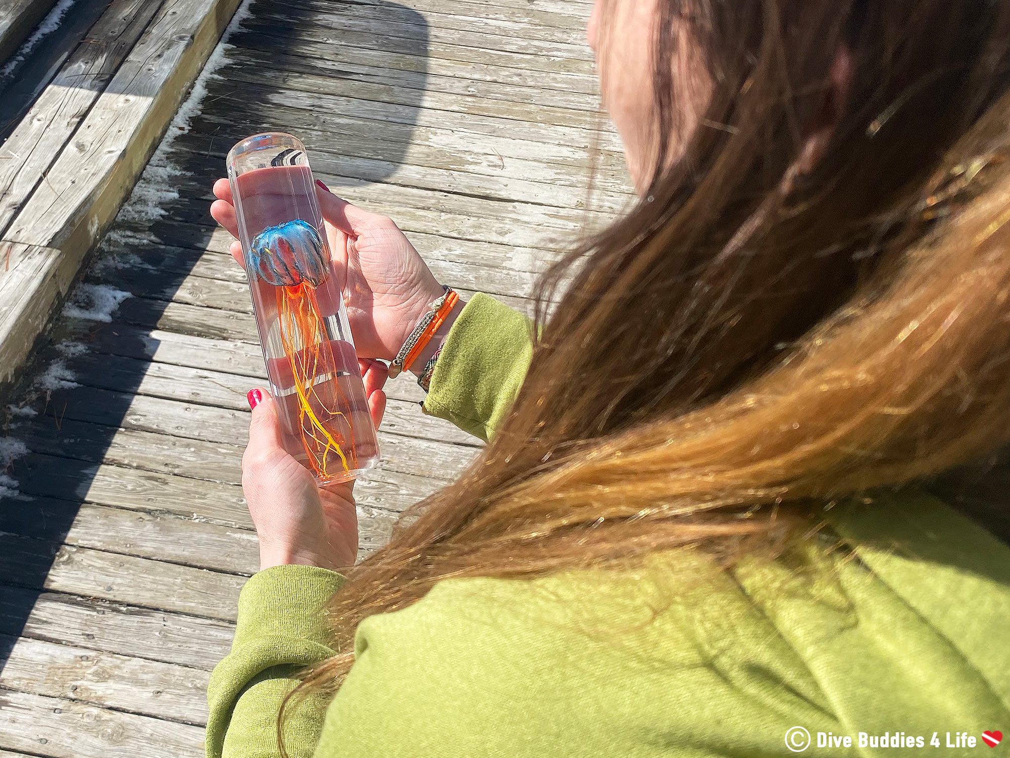 Ali Holding The Glass Jellyfish By La Meduse In Her Hands Outside
