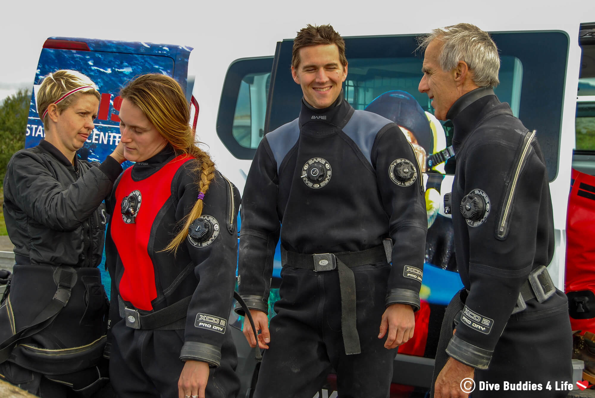 Ali, Joey And Dad Suiting Up In Drysuits To Dive The Silfra Crack In Iceland, Europe