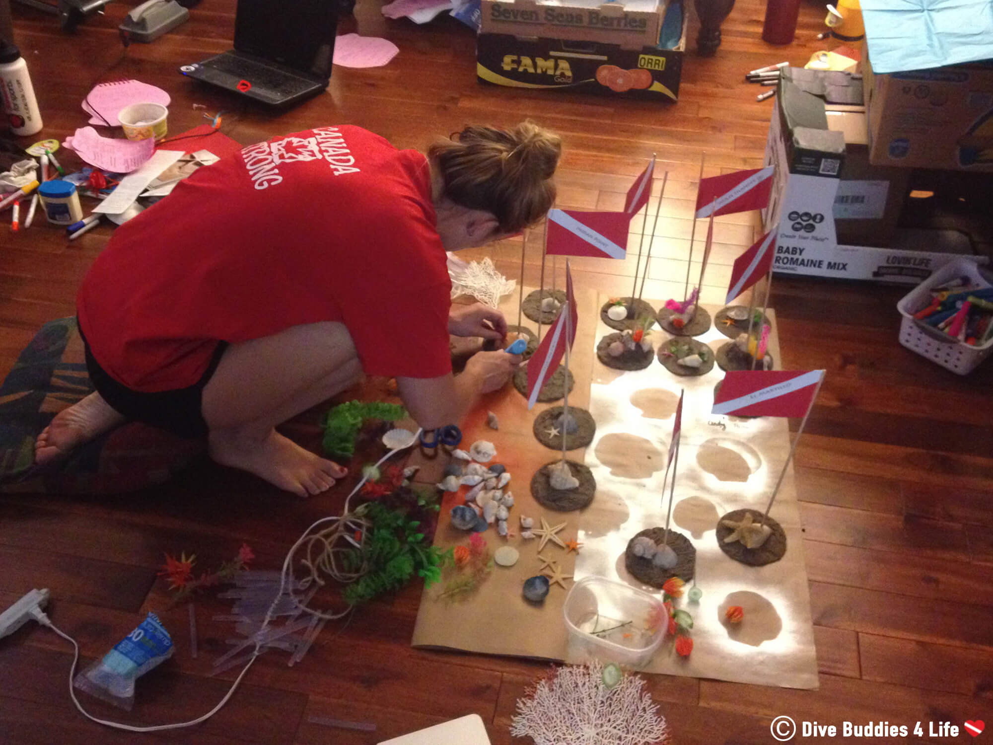Ali Preparing Dive Flags For The Center Pieces Of The Scuba Themed Wedding