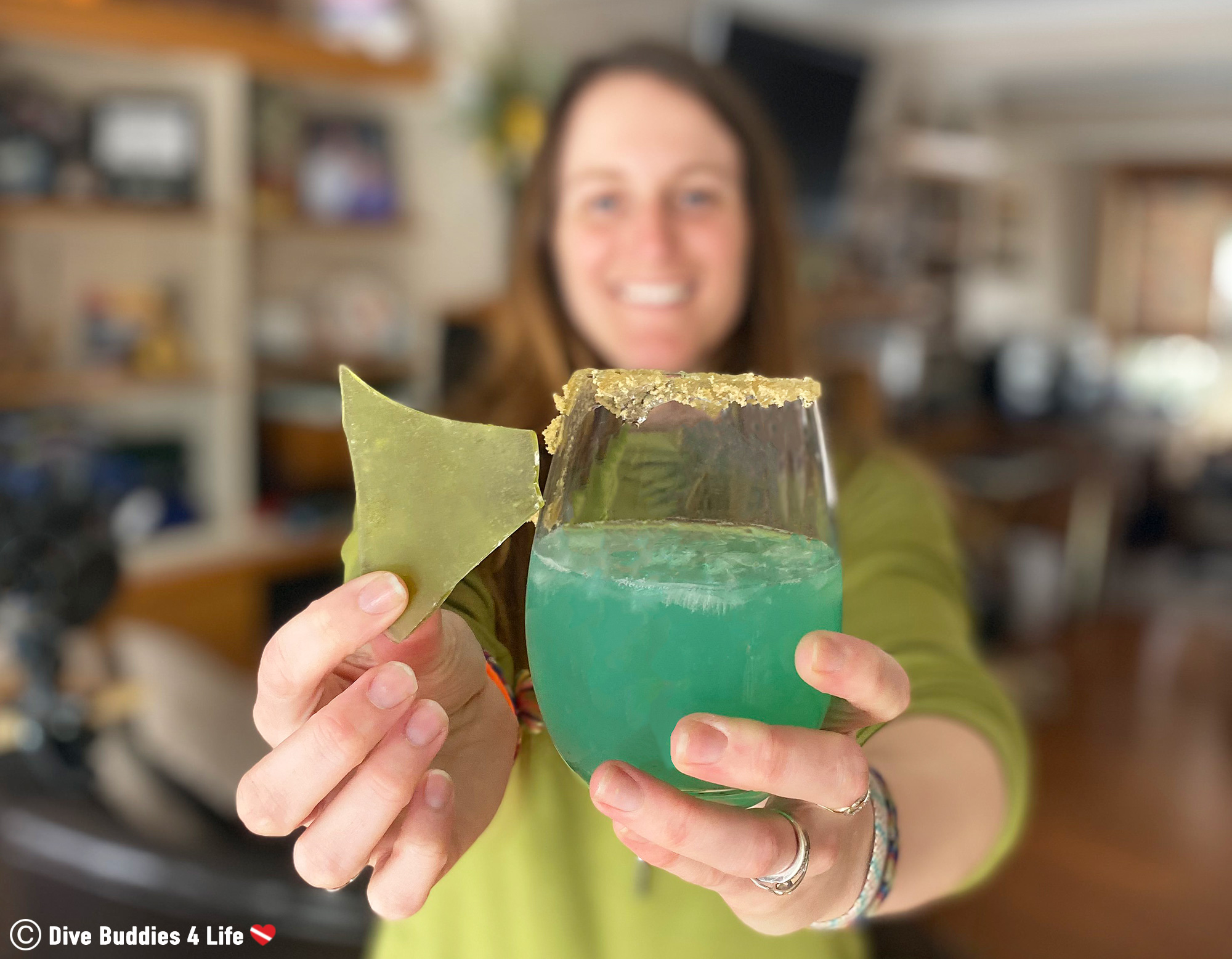 Ali Showcasing The Sea Glass Punch Drink