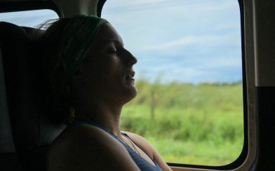 Ali Sleeping in the Shuttle Bus Transportation