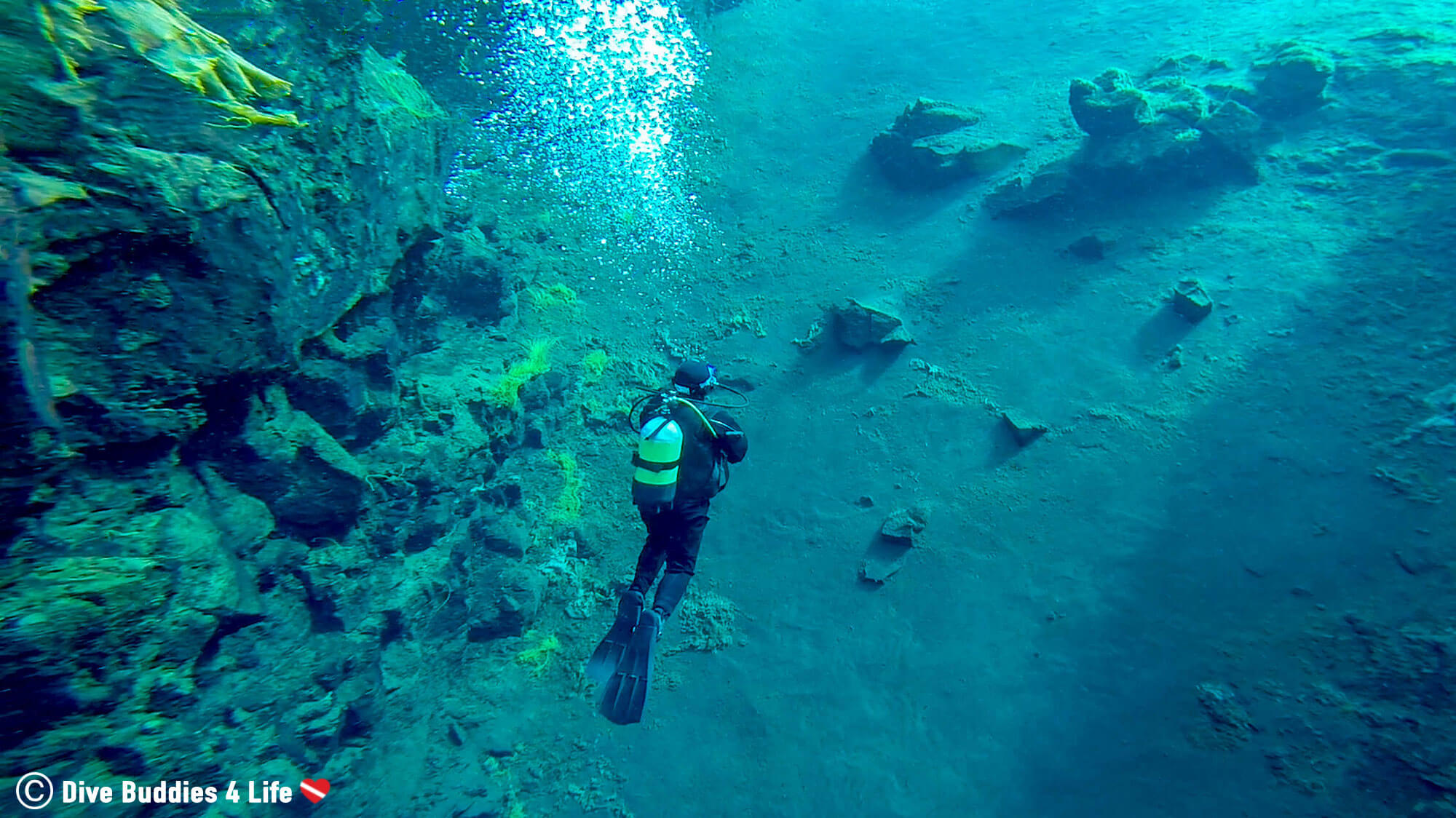 Ali Surfacing Up The Steep Sandy Silfra Cathedral Slope On A Dive In Iceland