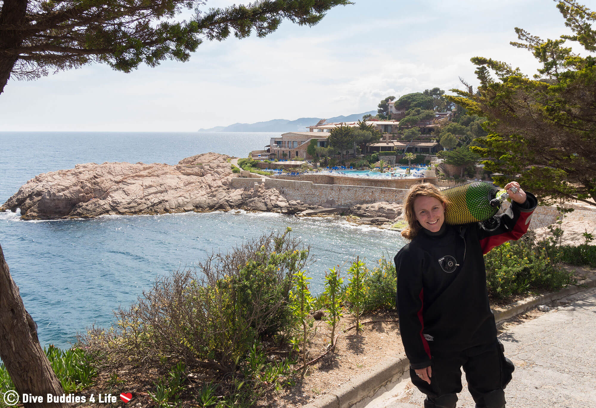 Ali Transporting A Scuba Diving Tank Down To The Shore Diving Site In Costa Brava, Spain, Europe