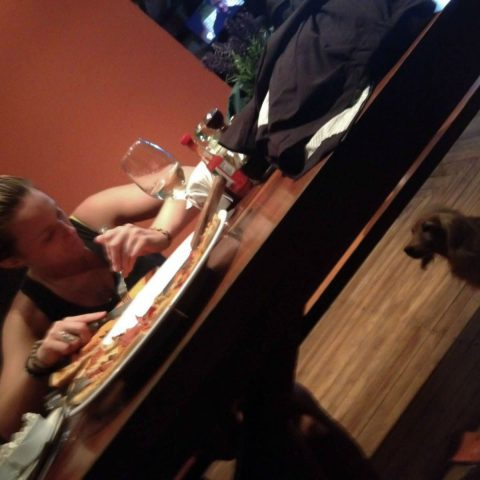 Ali at Supper Looking at the Dog
