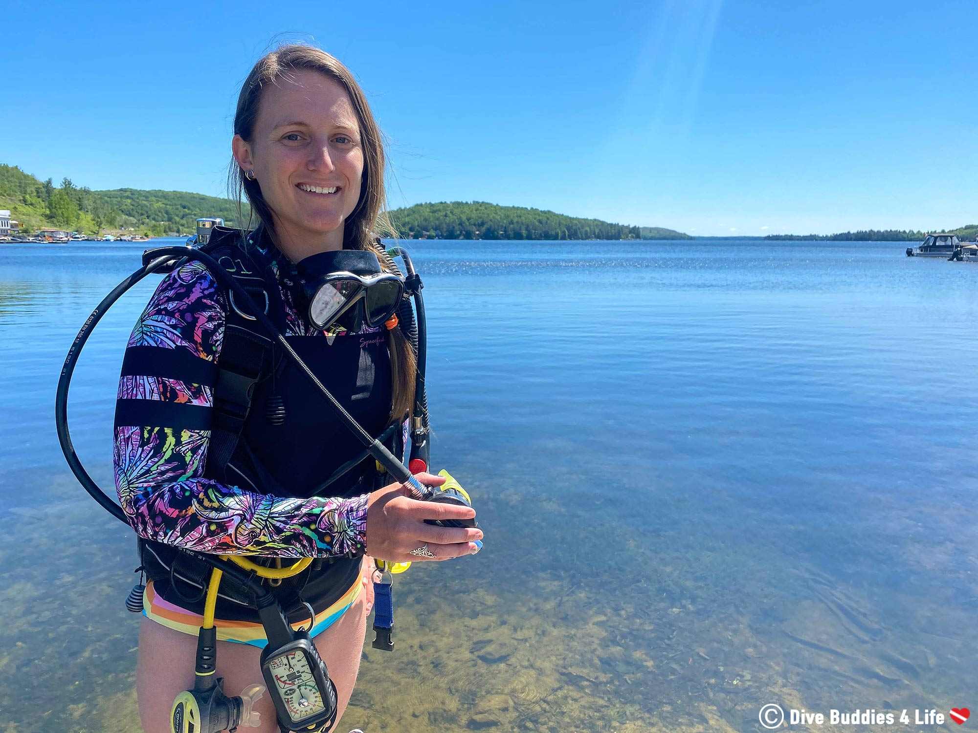 Ali At The Water Edge Holding Her Scuba Diving Regulator In The Spacefish Army Rashguard