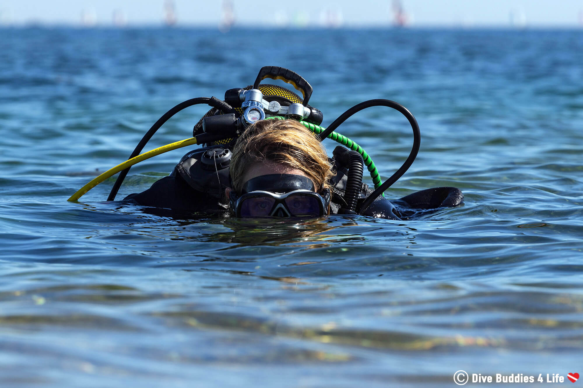 Ali In Scuba Diving Equipment Peeking Out Of The Water In France, Europe