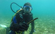 Ali With The End Of A Pipe In Lake Ohrid