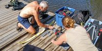 Alisha And Andy Preparing Scuba Diving Equipment Before Heading Into The Water In Temagami, Ontario, Canada