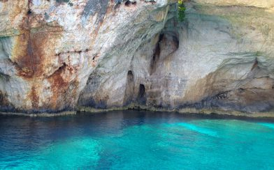 Azure Water And Cave Like Cliffs On Zakynthos