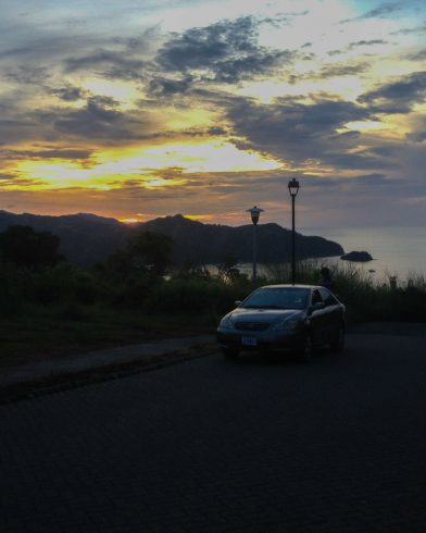 The Rental Car on the Hill with Costa Rican Sunset