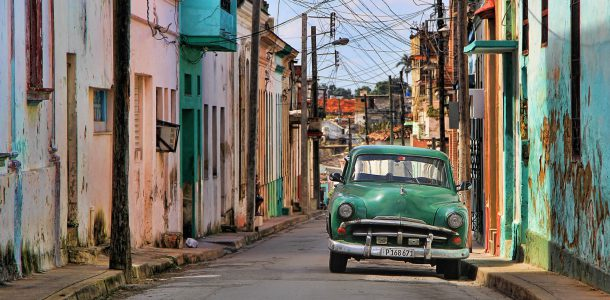 Cuban Streets with a Green Old Fashioned Car