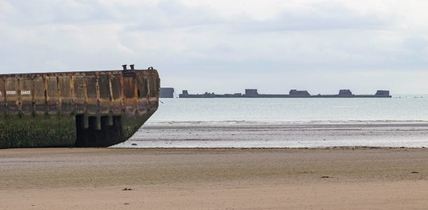 D-Day Landing Beach View With The Leftover Floating Pontoons, Normandy, France