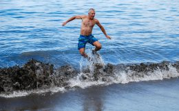 Dad Jumping in the Waves of Playa del Coco, Costa Rica