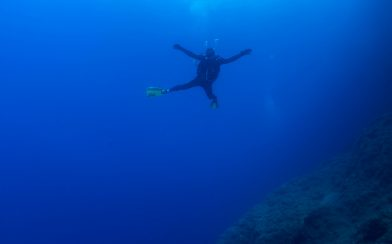Diver Floating In The Sea of Greece