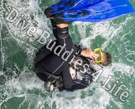 Female Scuba Diver Back Rolling Into The Water Scuba Shop 2
