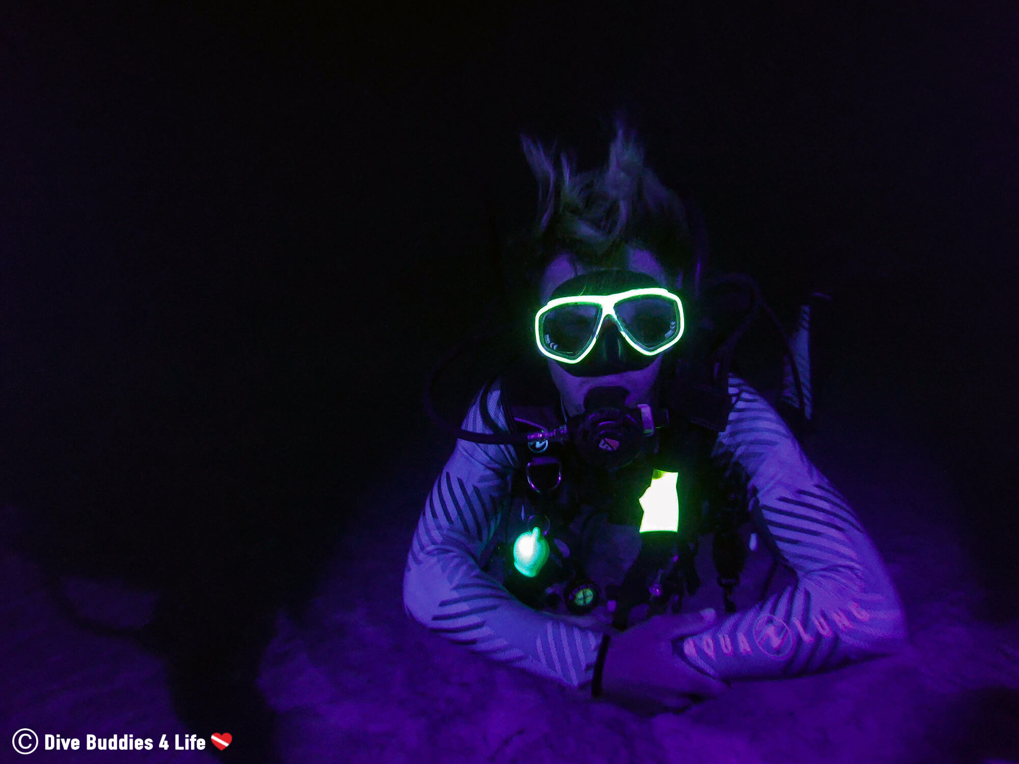 Fluorescent Diving Scuba Diver With A Neon Yellow Mask In Bonaire, Caribbean