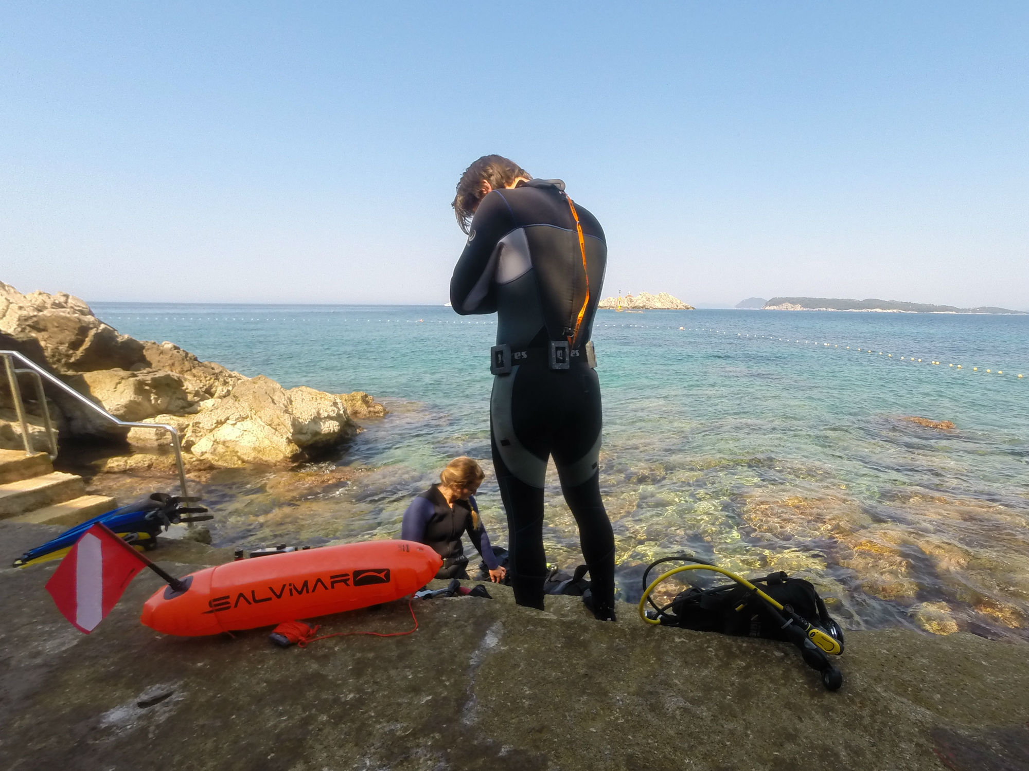 Joey and Ali Preparing to Scuba Dive in Croatia with a Surface Marker