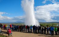 Group of People Around the Exploding Geysir