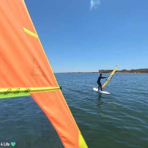 Heading Out On Windsurfing Boards In Spain's Mar Menor, On The Mediterranean Sea