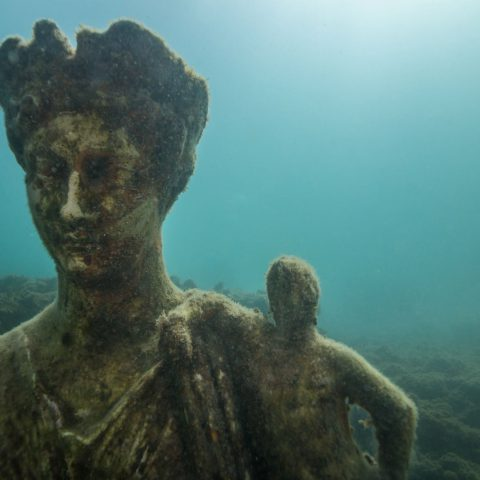 The Statue of a Queen in the Underwater City of Baia Near Naples, Italy