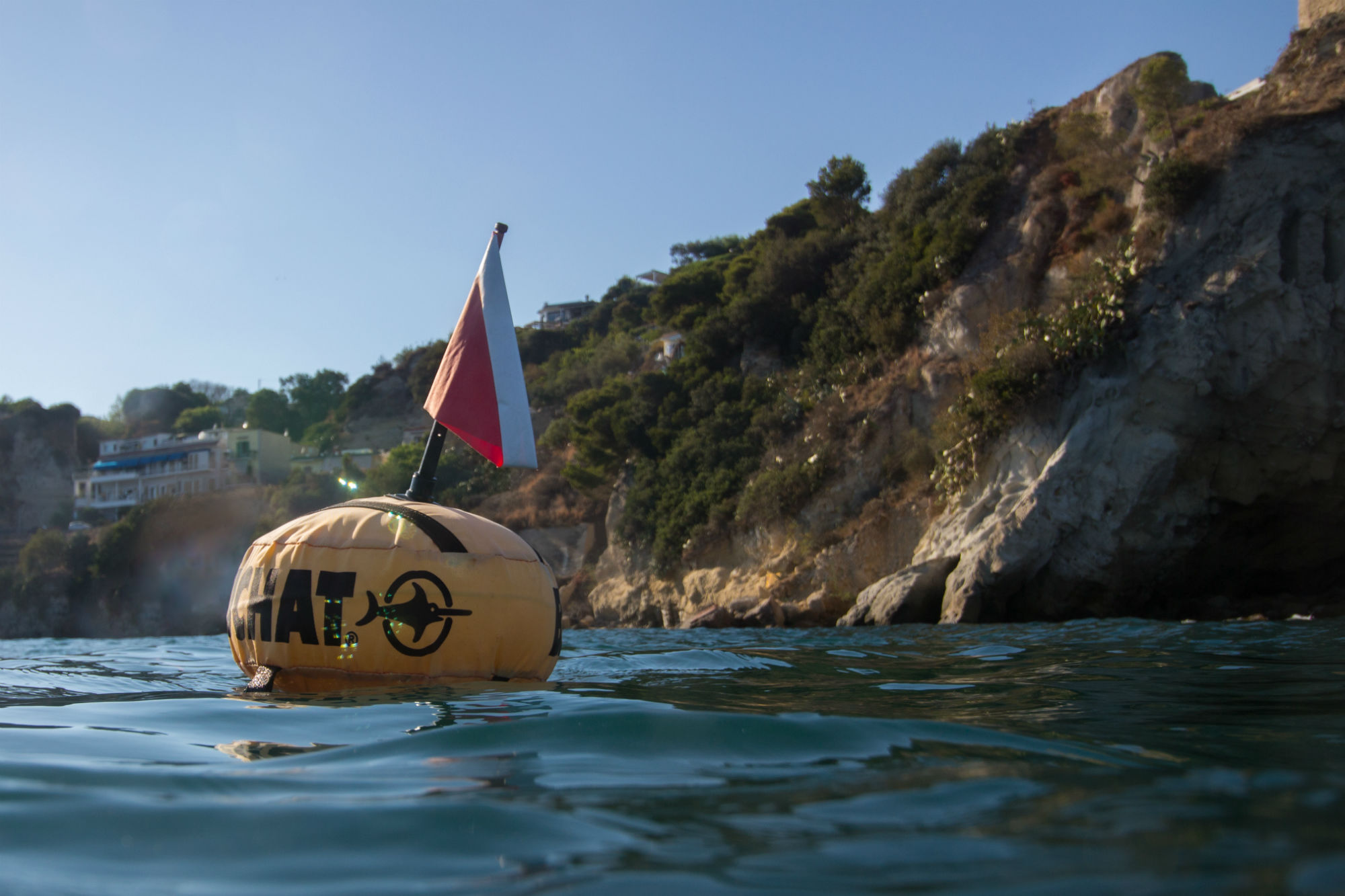 A Surface Marker Dive Buoy Floating at the Surface of the Water