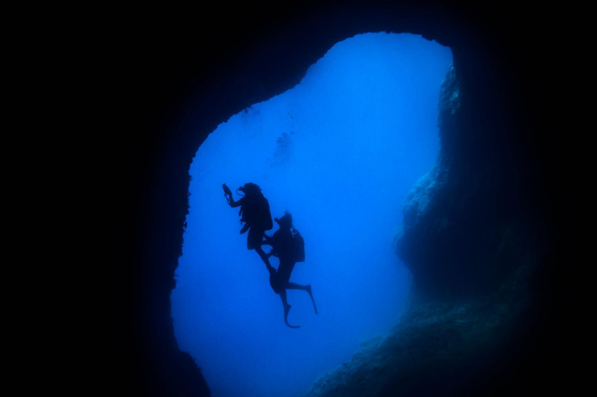 Scuba Diver Silhouettes in the Grotta dell'Isca