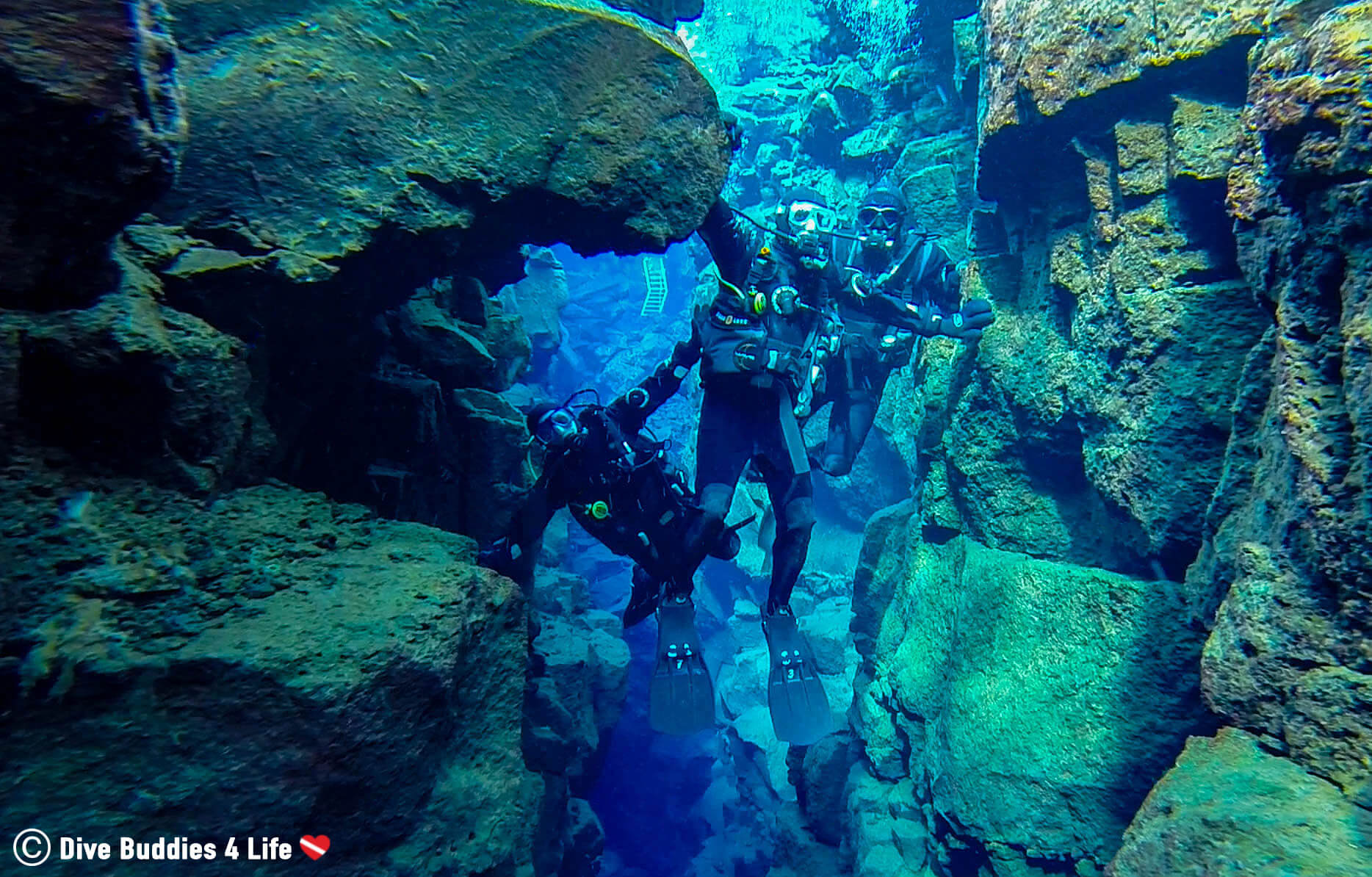 Joey, Andy And Ali Scuba Diving The Silfra In Iceland And Touching Both Continental Plates In The Big Rift
